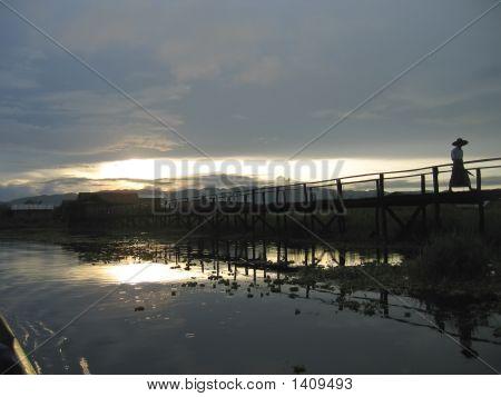 Sunset Over The Teck Bridge With A Walking Man, Inle Lake, Myanmar