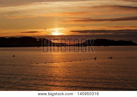 sunset from the beach of Baiona, Galicia, Spain