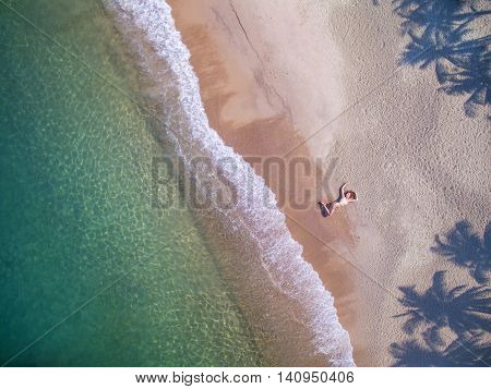 girl on the beach by aerial view