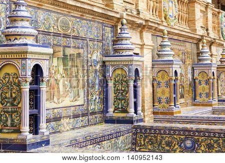 Seville, Spain - April 30, 2016: Detail of the artistic ceramic tile work of Province Alcoves at Plaza de Espana