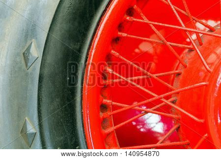 red needles automotive wheel and tire on antique car