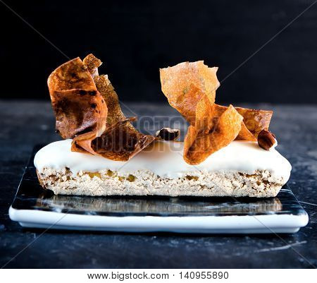 Delicious vanilla eclair with vanilla-praline and vanilla Chantilly Tahiti, decor, crunchy flakes Gavotte