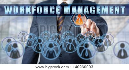 Enterprise manager is pushing WORKFORCE MANAGEMENT on an interactive touch screen. Business concept involving human resource management business software and technology.