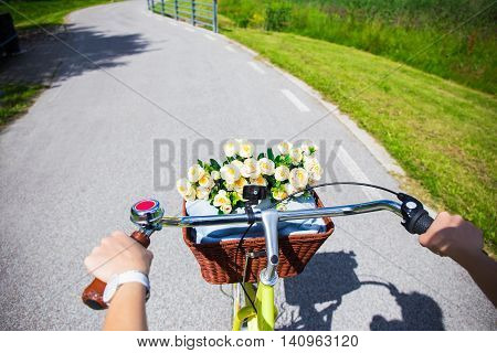 Woman Riding Vintage Bicycle With Wicker Basket - Handlebar View
