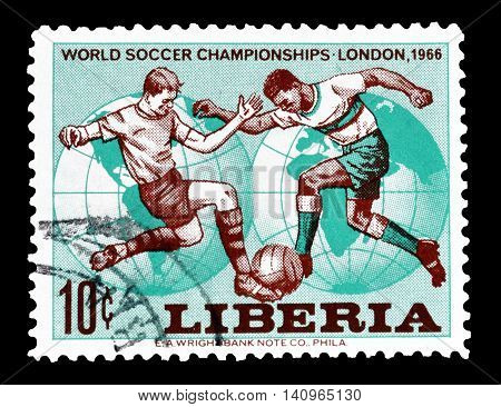 LIBERIA - CIRCA 1966 : Cancelled postage stamp printed by Liberia, that shows football players.
