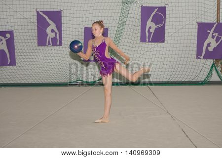 Warsaw Poland - June 25 2016: Young gymnast is with a ball