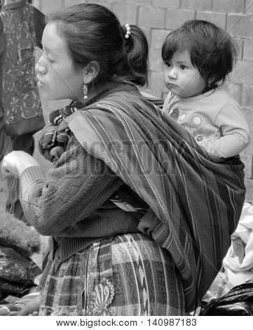 CHICHICASTENANGO GUSTEMALA APRIL 29 2016: Portrait of a Mayan baby and his mother. The Mayan people still make up a majority of the population in Guatemala,