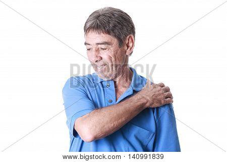 Portrait Of Elderly Man Suffering From Shoulder Pain