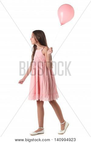 Lovely girl holding a pink balloon. Over white background. Love concept