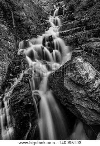 Alder Creek Falls Black and White tumbling over a rock cliff
