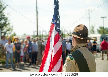 MERIDIAN IDAHO/USA - JULY 30 2016: Member from the Boy scouts waits to walk the flag to the gathering place for the pro police rally in Meridian Idaho
