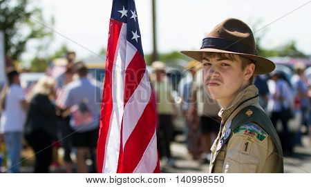 MERIDIAN IDAHO/USA - JULY 30 2016: Boy scout member holding the flag in a crowd of people gathered in support of the meridian police department