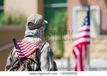 MERIDIAN IDAHO/USA - JULY 30 2016: Service member stands facing the flag to honor the meridian police department