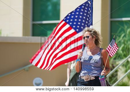 MERIDIAN IDAHO/USA - JULY 30 2016: Woman tells her story in support of teh local police at the pro police rally in Meridian Idaho