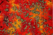 Red colored abstract image with grey and brown spots poster