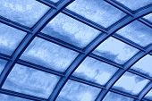Transparent blue toned glass roof with snow poster