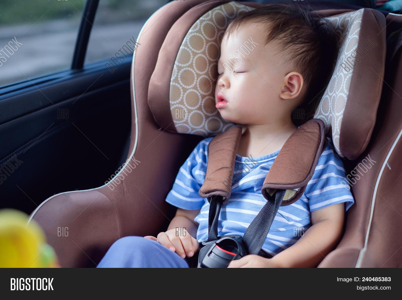 Cute Little Asian 18 Months 1 Year Toddler Baby Boy Child Sleeping In Modern Car