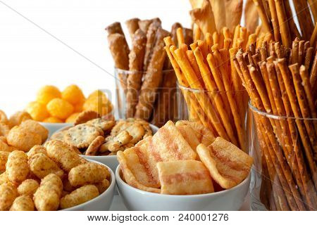 Selection Of Many Types Of Savory Snacks In White Ceramic Dishes And Glasses.