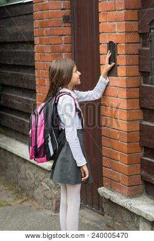 Teenage Girl Ringing In House Doorbell After Going To School