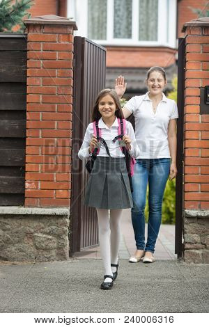 Teenage Girl In Uniform Going To School From Home