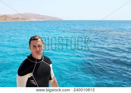 Diver In A Suit For Diving Is Preparing To Dive.