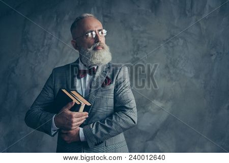 Portrait With Copy Space Of Successful, Attractive, Serious Millionaire In Jacket, Glasses, Holding