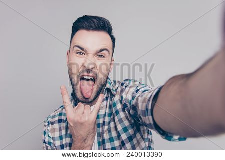 Self Portrait Of  Attractive, Crazy Man With Bristle, Stubble, Shooting Selfiye And Showing Rock And