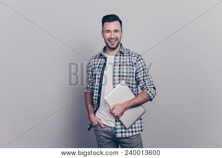 Portrait Of Smiling  Guy In Checkered Shirt Holding One Hand In Pocket And In Another One  Laptop, L