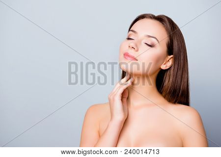 Concept Of Having Perfect Skin Without  Wrinkles. Beautiful Young Woman Is Enjoying Her Smooth Flawl