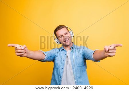 Portrait Of Caucasion, Positive Guy In Jeans Shirt With Bristle Listening His Favorite Music, Singin