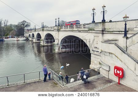 Kingston Upon Thames, United Kingdom - April 2018: Tourists Feeding Waterbirds And Swans At Kingston