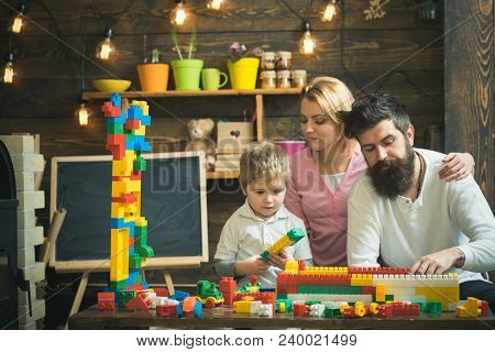 Family Leisure Concept. Parents Hugs, Watching Son Playing, Enjoy Parenthood. Kid With Parents Play