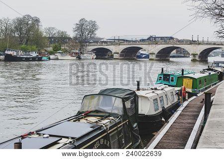 Kingston Upon Thames, United Kingdom - April 2018: Local Boat Docking At Riverside Walk Promenade By