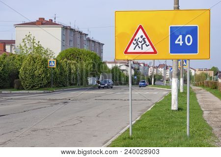 Road Signs Warning Of Children And Recommended Speed. They Stand At The School.