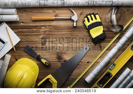Construction And Renovation Concept. Building Contractor Tools On Wooden Table. Top View.