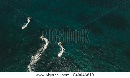 People Riding On A Jet Ski. Aerial View Man Driving A Jet-ski At Sea.jet Ski On The Water Of The Sea