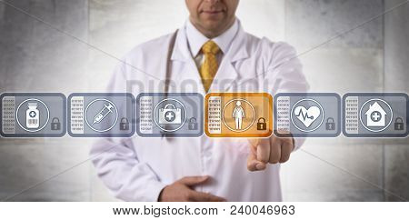 Unrecognizable Physician Accessing Medical Records Of A Female Patient By Choosing A Secure Block In