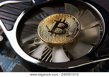 Bitcoin And Video Card, Close-up. Cryptocurrency Mining Concept With Golden Bitcoins. Bitcoin Mining