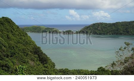 Seascape Tropical Island, Lagoon, Beach And Hills.. Tropical Landscape Sky, Clouds And Mountains Roc