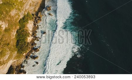 Aerial View Of Rocky Coast With Surf The Waves Off The At Sunset, Bali, Indonesia, Pura Uluwatu Clif