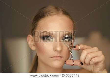Woman Use Eyelash Curler For Eye Makeup. Woman Curl Lashes With Beauty Tool, Look. Model With Curly