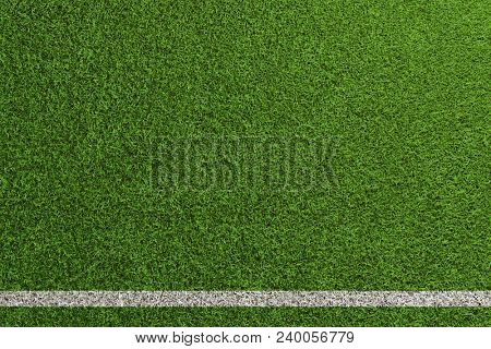 Green lawn of a soccer and football playing field seen from above (3D Rendering)