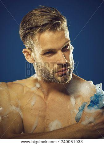 Bearded Macho Washing With Sponge. Closeup Young Man Washing Muscular Body. Health Care Concept. Han
