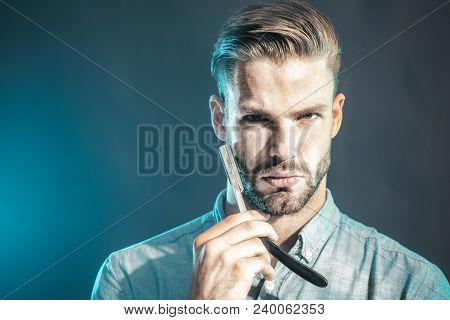 Portrait Of Barber In Stylish Clothes Shows Straight Razor. Bearded Man With Long Beard, Brutal, Cau