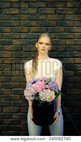Girl Beauty, Fashion, Look. Woman Hold Vase With Hydrangea Flowers On Brick Wall. Womens Day, 8 Marc