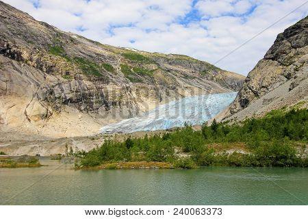 Nigardsbreen Glacier, A Beautiful Arm Of The Large Jostedalsbreen Glacier. Nigardsbreen Lies About 3