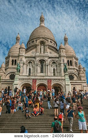 Paris, France - July 08, 2017. People And Basilica Of Sacre Coeur Facade In Paris. Known As The