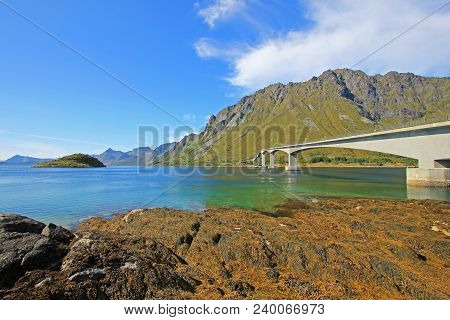 Mountain and fjord landscape, norwegian sea at Holandsmelen, Vestvagoy, Lofoten Islands, Scandinavia, Norway poster