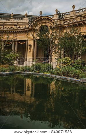 Paris, France - July 11, 2017. People And Garden Pond In The Courtyard Of Petit Palais In Paris. Kno