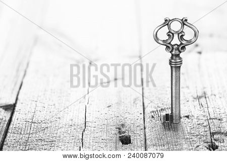 Retro Key On Wooden Planks With Copy Space
